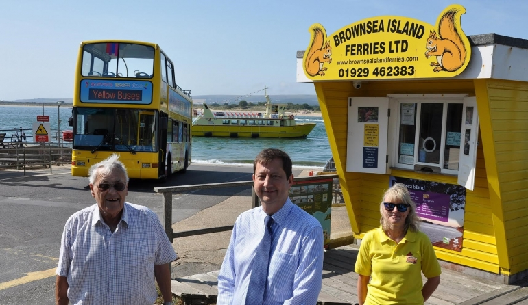 David Hedgeman of Brownsea island Ferries, David Squire from Yellow Buses and Paula Payne from the ferry company